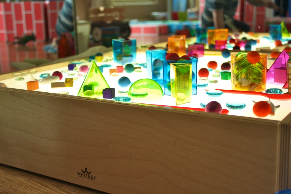 Felt balls, wooden cubes, glass stones, and translucent Geometric Solids. It's so pretty; who wouldn't want to explore?